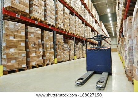 Manual forklift pallet stacker truck equipment at food warehouse - stock photo