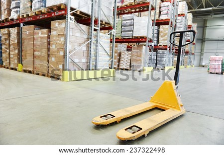 Manual forklift pallet stacker truck equipment at warehouse - stock photo