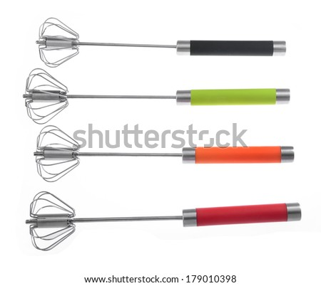 Manual hand egg beater mixer isolated over white background - stock photo