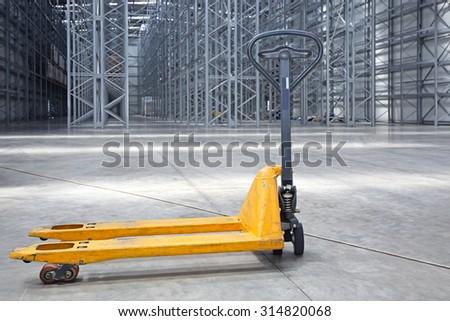 Manual Pallet Jack in Distributin Center Warehouse - stock photo