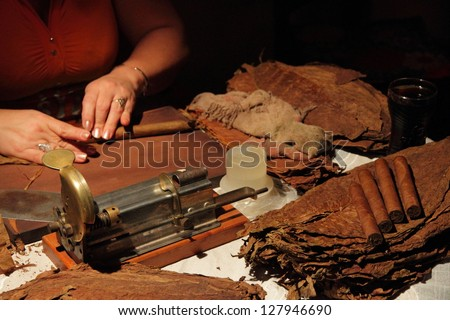 Manual production of cigars - stock photo