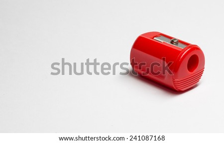 Manual red pencil sharpener isolated on the white background - stock photo