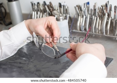 manual work by an optician