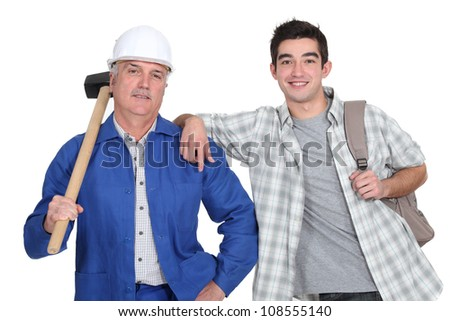 Manual worker and a young man with a rucksack - stock photo