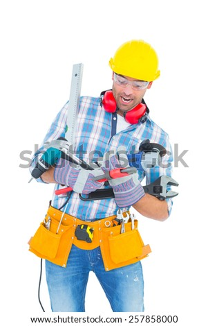 Manual worker balancing various tools on white background - stock photo