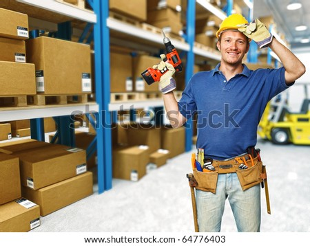 manual worker in a  classic warehouse and forklift in action - stock photo