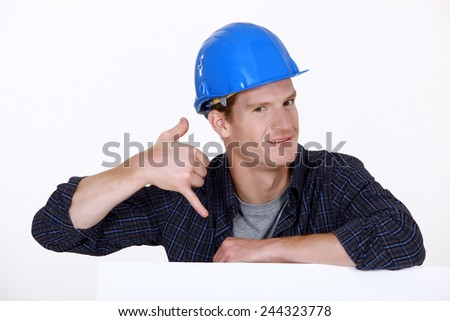 Manual worker making a phone shape - stock photo