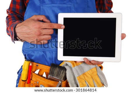 Manual worker man with tablet isolated on white background - stock photo