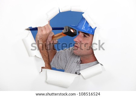 Manual worker using hammer and chisel - stock photo