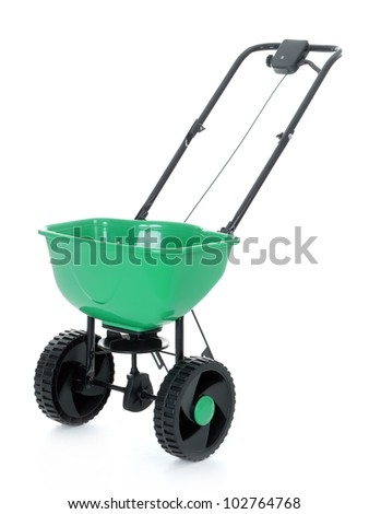 Manually operated seeder shot on white - stock photo