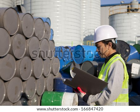 Manufacture worker check the number of drums - stock photo