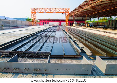 Manufacturing concrete slabs. - stock photo