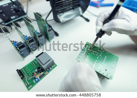 Manufacturing of electronic devices soldering surface mount parts - stock photo