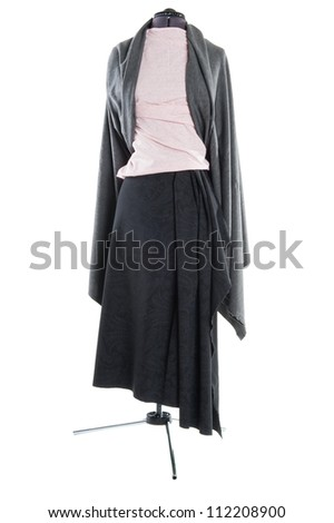 manufacturing women's clothing from fabric on a mannequin - stock photo