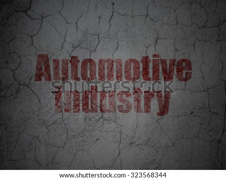 Manufacuring concept: Red Automotive Industry on grunge textured concrete wall background