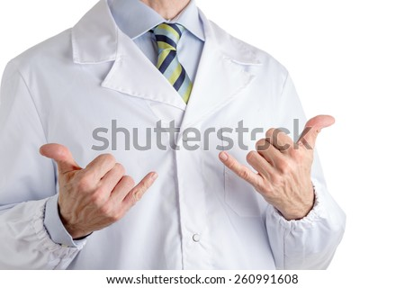 Manwith medical white coat, blue shirt and regimental tie is making  hitch-hiking gesture with both hands meaning success or everyting is all right. Gesture is approve or like or number one sign too - stock photo