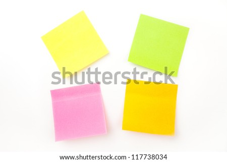 Many adhesive notes against a white background