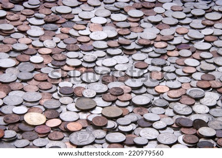 many American coins, quarters, nickels, dimes, pennies, fifty cent piece, dollar coins - stock photo