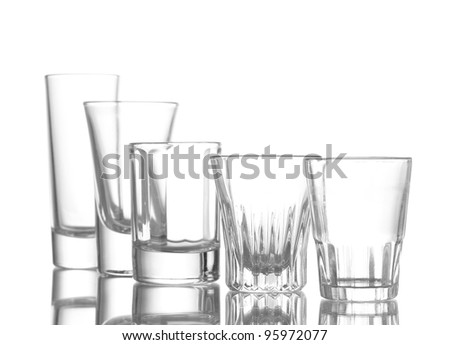 Many an empty wineglass isolated on white