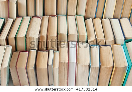Many antique books in a book library. Book library concept - stock photo