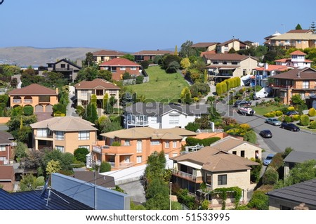 Many australian family houses on the hills - stock photo