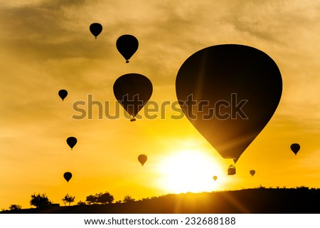 Many balloons at sunset sky background - stock photo