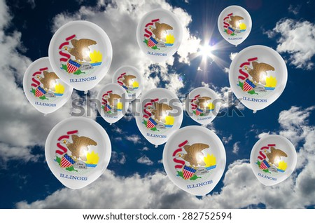 many balloons in colors of illinois flag flying on sky - stock photo