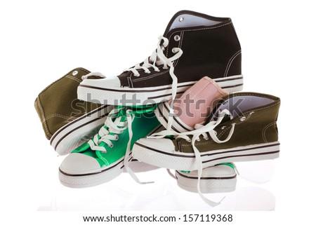 many basketball shoes isolated over white background - stock photo
