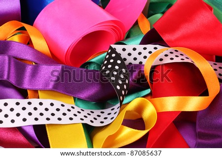 many beautiful bright satin ribbons - stock photo