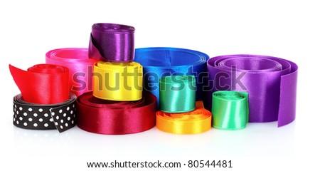 many beautiful bright satin ribbons isolated on white - stock photo