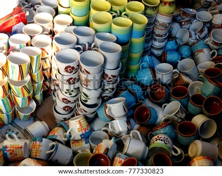 Many beautiful sets of pottery coffee cups for sale at an Indian store close up