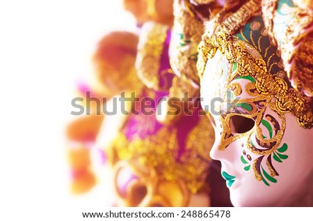 Many beautiful Venetian masks decorated with gold, gorgeous art border, traditional carnival face accessory, luxury European vintage art