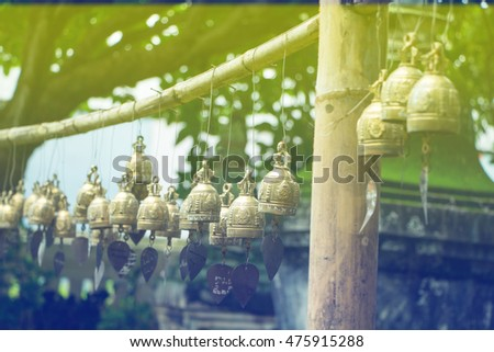Many bells at temples in northern Thailand. made with gradient style for background.