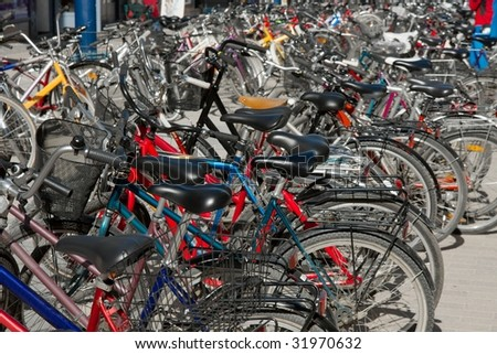 Many bicycles parked on the street