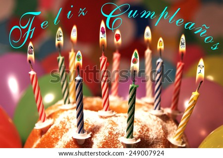 many birthday wishes inside candlelight and Birthday greetings in Spanish language - stock photo