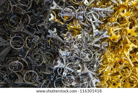 Many black, grey and golden key-rings of Tour Eiffel - stock photo