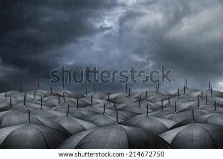 many black umbrellas in rainy weather - stock photo