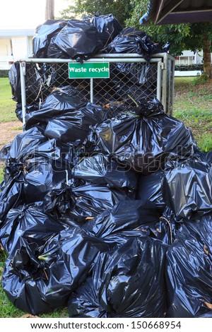 Many black waste bag - stock photo