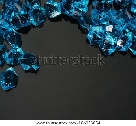 Many blue gems on black - stock photo