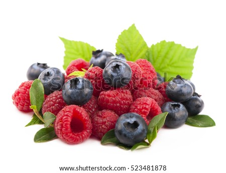 Many blueberries and raspberries. Isolated white