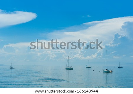 Many boats on the lake with beautiful clouds