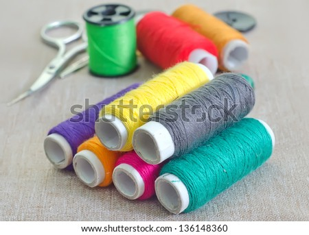 Many bobbin of thread with needle - stock photo