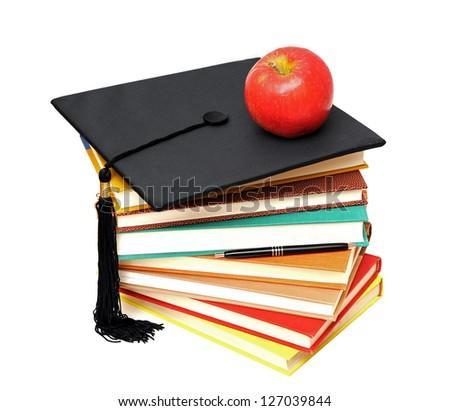 many books , apple and graduated cap - stock photo