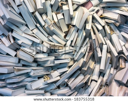 many books are completely messed up on a pile - stock photo