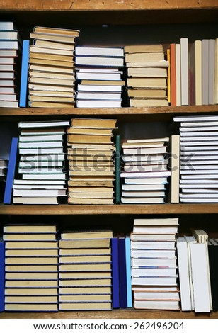 Many books on bookshelf in library - stock photo