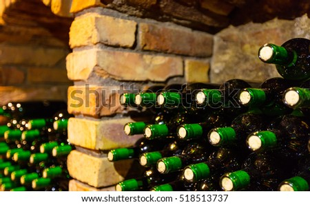 Many bottles in wine cellar, side view, low depth of focus