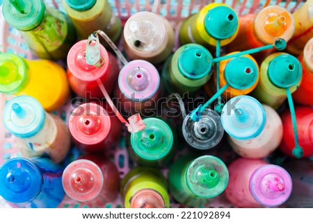 many bottles of watercolour paint, narrow focus, top view