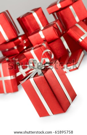 many boxes of gifts on a gray background