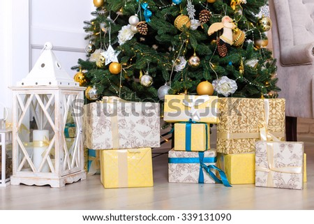 Many boxes with a christas gifts near the tree