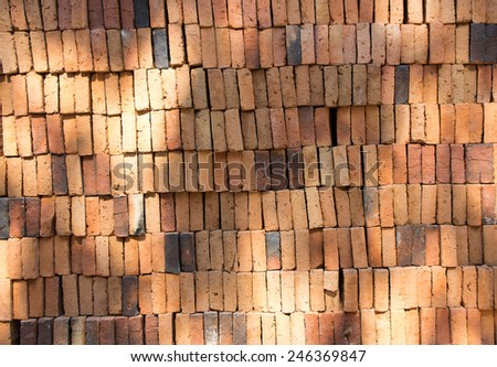 Many brick stacked for use in the construction